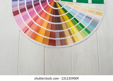 Different colour sampler on wooden background closeup