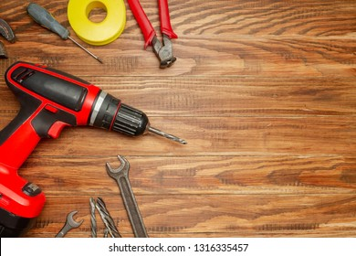 different construction tools on wooden background with copy space. diy construction tools on the brown table - Shutterstock ID 1316335457