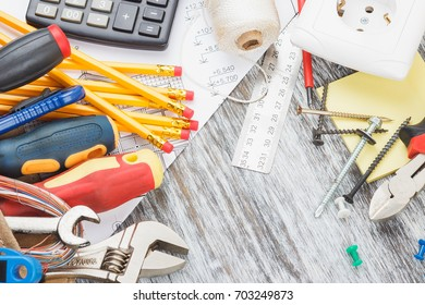 Different construction tools on the wooden background