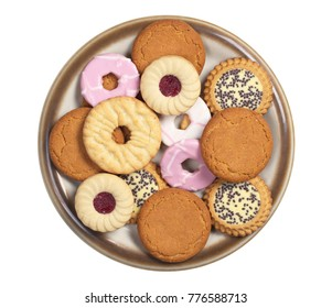 Different cookies in a plate isolated on a white background, top view
