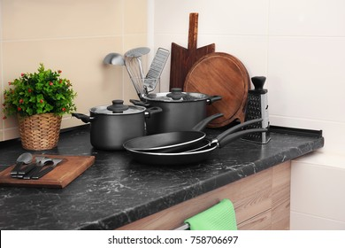 Different cooking utensils on table in kitchen