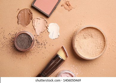Different cosmetic products on color background