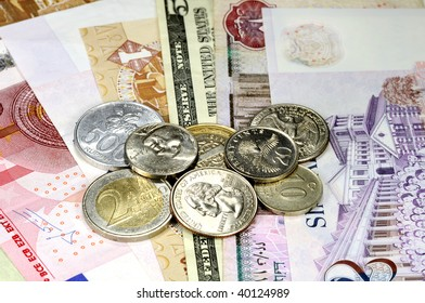 Different countries' coins and banknotes