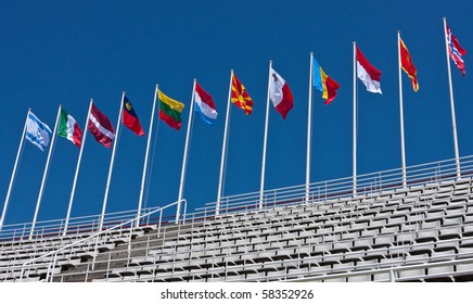 Different countries flags blowing in the wind in a stadion