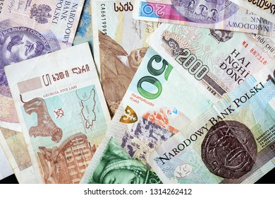 Different countries money background close up. Belarusian rubles, Georgian lari, Polish zloty, Israeli shekels, Vietnamese dongs