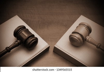 Different court decisions concept with two wooden gavels and legal books