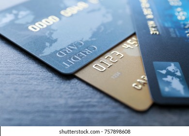 Different credit cards on table, closeup