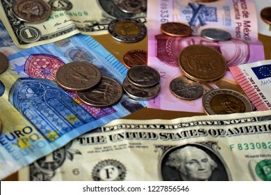 Different currencies (coins and bills)