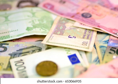 Different currency note and coins from different countries background