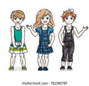 Different cute little girls standing in stylish casual clothes. set of beautiful kids illustrations.