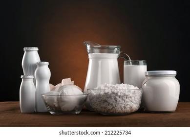 Different dairy products: cheese, sour cream, milk, yogurt, kefir.