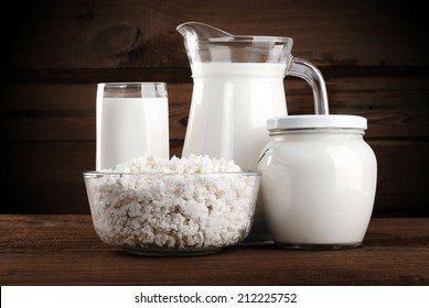 Different dairy products: cheese, sour cream, milk, yogurt, kefir.
