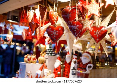 Different decoration, toy for xmas tree on christmas market, close up of cozy handmade hearts