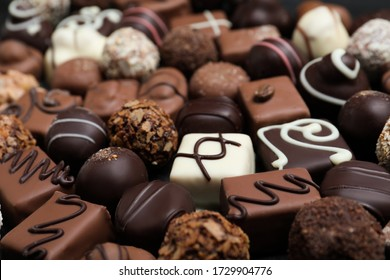 Different delicious chocolate candies as background, closeup