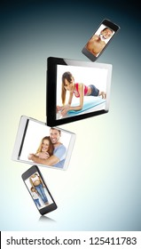 different digital tablets and smart phones with photos