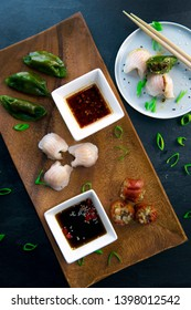 Different dumplings served with sauces