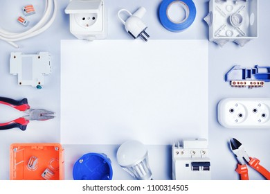 Different electrical tools and equipments with white paper for text.Electrical background.