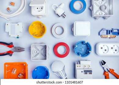 Different electrical tools on light grey background with plase for text, top view.