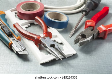 Different electrical tools on metallic background. Energy concept.
