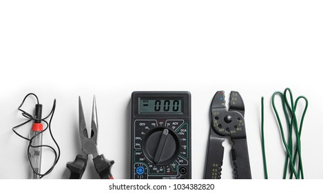 Different electrical tools on white background