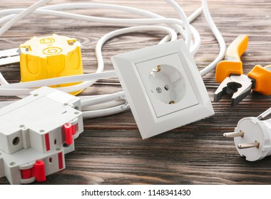 Different electrician's supplies on wooden background