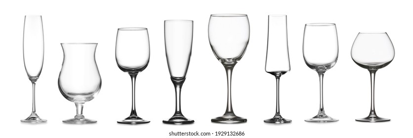 Different empty glasses on white background