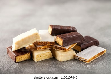 different Energy protein bar on grey background.