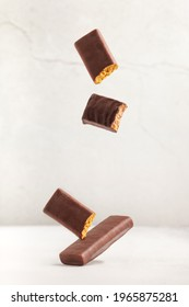 Different energy protein bar on grey background. Flying levitation