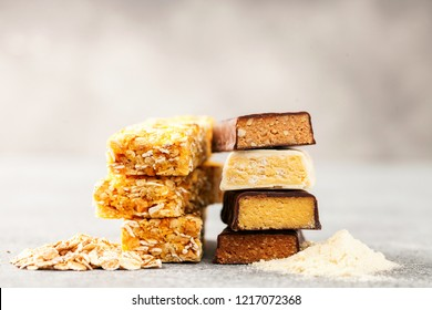 Different Energy protein bars and oatmeal bars on grey background.   Set of energy, sport, breakfast and protein bars