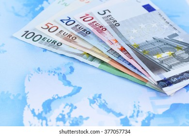 Different euro banknotes on a map background