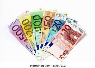 Different euro bills arrayed.