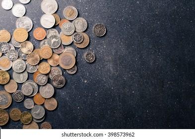 Different european coins on dark background