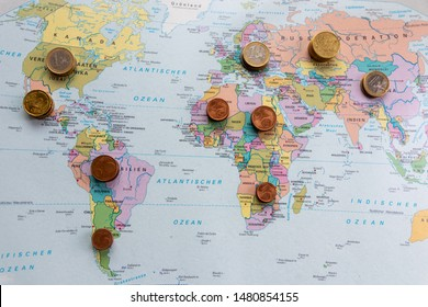Different european coins on a global map illustrate the financial wealth of the different continents and countries all over the world and lucrative global trading markets for the financial sector