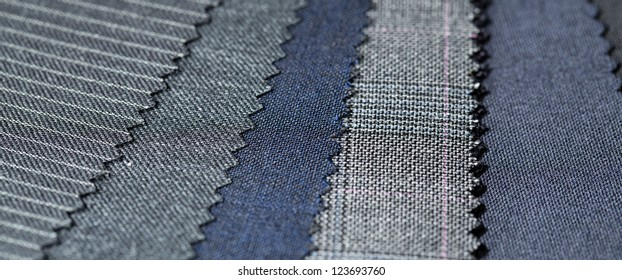 Different fabric to be chosen for tailor made suit, pointing to the wide variety of choice