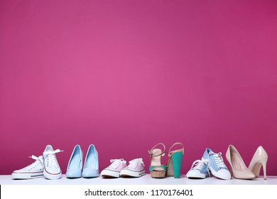 Different female shoes on pink background