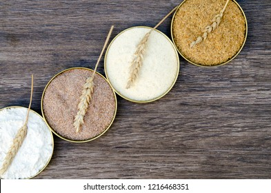 Different flour of wheat cereal in circle pots.Texture of four wheat in mill:milled wheat sprouts, wheat bran,semolina flour,durum.Storage in kitchen closet,Flat lay,copy space for text