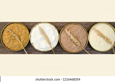 Different flour of wheat cereal in circle pots.Texture of four wheat in mill:milled wheat sprouts, wheat bran,semolina flour,durum.Top view,copy space for text