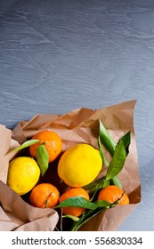 Different food in paper bag on grey background, close up. Grocery shopping concept, top view