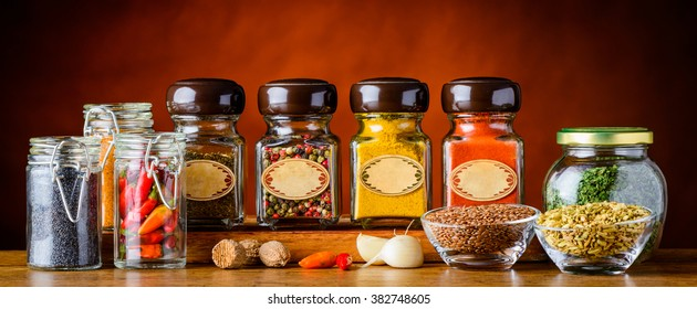 Different food spices and seasoning in glasses. Pepper, poppy seeds, paprika, curry