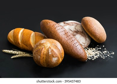 Different fresh bread on a black background
