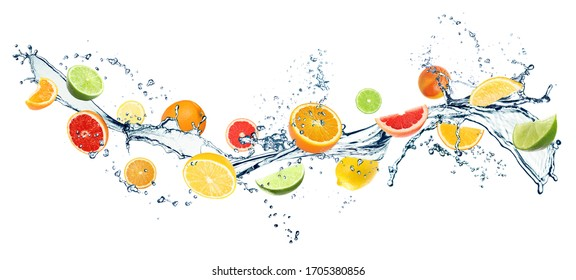 Different fresh citrus fruits and splashing water on white background. Banner design