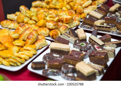Different fresh pastry and  in buffet and small cakes