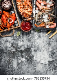 Different fresh seafood. On a rustic background.
