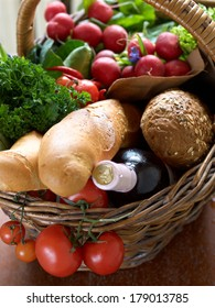 Different fresh vegetables in basket on wooden background with selective focus