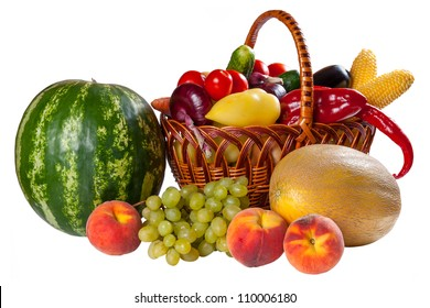Different fresh vegetables in wicker basket and fruit isolated on a white background