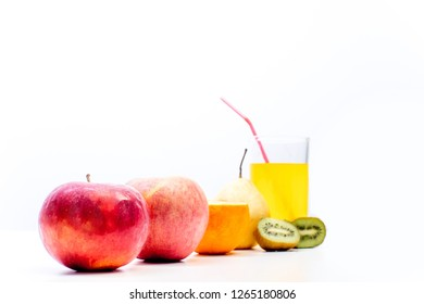 different fruit and juice or smoothie in a glass