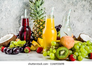 Different fruit juices smoothies concept, summer vitamins diet, with tropical fruits and berries on a light background,
