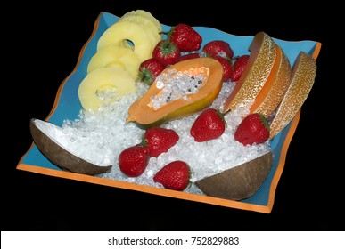 Different fruits in bowl with ice
