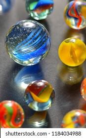 Different glass balls on black background