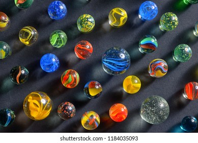 Different glass balls on black background